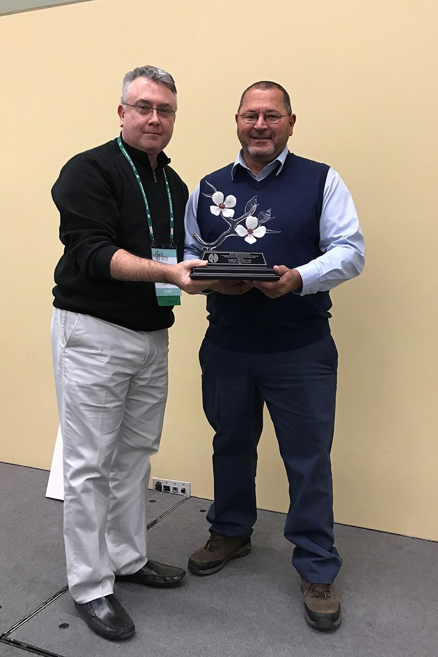 Danny Summers (left) presents Buddy Lee (right) with the 2018 Don Shadow Award of Excellence